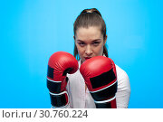 Купить «Ready for a fight. Determined business woman wearing boxing gloves.», фото № 30760224, снято 12 марта 2019 г. (c) Pavel Biryukov / Фотобанк Лори