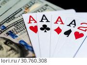 Купить «Playing Cards and Stack of 100 American Dollars Bills.», фото № 30760308, снято 22 мая 2019 г. (c) Pavel Biryukov / Фотобанк Лори