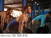 Купить «Side View - Sporty Athletic Men Training With Barbells.», фото № 30760416, снято 3 февраля 2019 г. (c) Pavel Biryukov / Фотобанк Лори