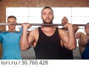 Купить «Group of Young Men in Gym Training With Barbells.», фото № 30760428, снято 3 февраля 2019 г. (c) Pavel Biryukov / Фотобанк Лори