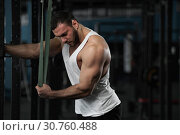 Купить «Muscular Handsome Man Posing in Gym.», фото № 30760488, снято 3 февраля 2019 г. (c) Pavel Biryukov / Фотобанк Лори