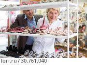 Купить «Man help woman choose shoes», фото № 30761040, снято 22 сентября 2019 г. (c) Яков Филимонов / Фотобанк Лори