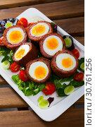 Купить «Scotch eggs with vegetables and greens», фото № 30761256, снято 20 июня 2019 г. (c) Яков Филимонов / Фотобанк Лори
