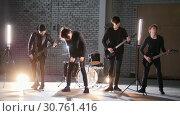 Купить «A perspective rock group having a repetition.», видеоролик № 30761416, снято 6 июля 2020 г. (c) Константин Шишкин / Фотобанк Лори