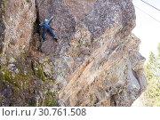Купить «Девочка занимается скалолазанием, лезет на скалу со страховкой», фото № 30761508, снято 21 апреля 2019 г. (c) Лариса Капусткина / Фотобанк Лори