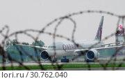Купить «Cargo airplane taxiing after landing», видеоролик № 30762040, снято 4 мая 2019 г. (c) Игорь Жоров / Фотобанк Лори
