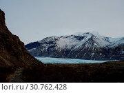 Купить «A glacier in Iceland between some mountains», фото № 30762428, снято 30 декабря 2017 г. (c) easy Fotostock / Фотобанк Лори