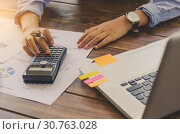 Купить «Businessman are working with a calculator and laptop. in office business concept», фото № 30763028, снято 13 марта 2017 г. (c) easy Fotostock / Фотобанк Лори