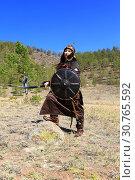 Купить «Женщина с мечом в руках в костюме воина Чингисхана», фото № 30765592, снято 4 мая 2019 г. (c) Валерий Митяшов / Фотобанк Лори