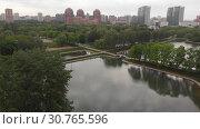 Купить «Festival ponds in Park Druzhby of Levoberezhnyy district of Moscow, Russia.», видеоролик № 30765596, снято 23 мая 2019 г. (c) Володина Ольга / Фотобанк Лори