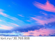 Купить «Sunset colorful sky background with pink, purple and blue dramatic colorful clouds», фото № 30769808, снято 21 ноября 2018 г. (c) Зезелина Марина / Фотобанк Лори