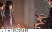 Купить «A repetition. A young group of people playing rock music enjoying it», видеоролик № 30769816, снято 6 июля 2020 г. (c) Константин Шишкин / Фотобанк Лори