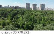Купить «Top view of the park Severnoye Tushino in Moscow, Russia.», видеоролик № 30770272, снято 16 июня 2019 г. (c) Володина Ольга / Фотобанк Лори