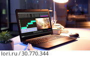 Купить «video editor program on laptop at night office», видеоролик № 30770344, снято 23 мая 2019 г. (c) Syda Productions / Фотобанк Лори
