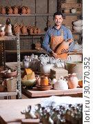 Купить «Craftsman in ceramic workshop», фото № 30770352, снято 23 июля 2019 г. (c) Яков Филимонов / Фотобанк Лори
