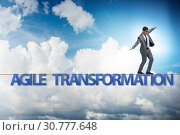 Купить «Agile transformation concept with businessman walking on tight r», фото № 30777648, снято 2 июня 2020 г. (c) Elnur / Фотобанк Лори