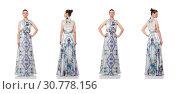 Купить «Beautiful girl in elegant long dress isolated on white», фото № 30778156, снято 23 июня 2015 г. (c) Elnur / Фотобанк Лори