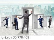 Купить «Businessman in uncertainty concept with many doors», фото № 30778408, снято 18 июня 2019 г. (c) Elnur / Фотобанк Лори