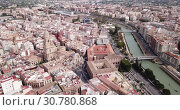 Купить «Aerial panoramic view of Murcia cityscape with bell tower of Cathedral Church of Saint Mary, Spain», видеоролик № 30780868, снято 17 апреля 2019 г. (c) Яков Филимонов / Фотобанк Лори