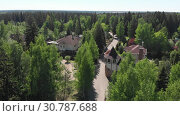 Купить «View from height of private residential buildings in a pine forest in Russia», видеоролик № 30787688, снято 23 мая 2019 г. (c) Володина Ольга / Фотобанк Лори