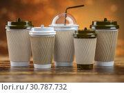 Купить «Set of coffee paper cups.Mockup template for cafe shop. Differnt types of coffee.», фото № 30787732, снято 19 июня 2019 г. (c) Maksym Yemelyanov / Фотобанк Лори