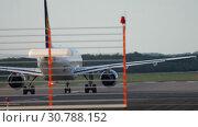Купить «Airplane start position before departure», видеоролик № 30788152, снято 21 июля 2017 г. (c) Игорь Жоров / Фотобанк Лори