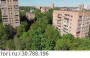 Купить «The Cityscape in Khimki city from above. Russia», видеоролик № 30788196, снято 21 мая 2019 г. (c) Володина Ольга / Фотобанк Лори
