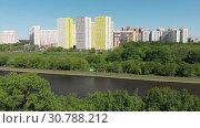 Купить «The Cityscape of Levoberezhnyy district in Khimki city. Russia», видеоролик № 30788212, снято 22 мая 2019 г. (c) Володина Ольга / Фотобанк Лори