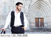 Waist up portrait of man near iron banisters. Стоковое фото, фотограф Яков Филимонов / Фотобанк Лори