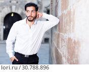Купить «Thoughtful man leaning elbow on wall», фото № 30788896, снято 5 августа 2017 г. (c) Яков Филимонов / Фотобанк Лори