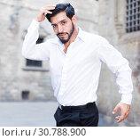 Купить «Passionate man dancing alone outdoors», фото № 30788900, снято 5 августа 2017 г. (c) Яков Филимонов / Фотобанк Лори