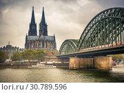 Купить «Cologne Cathedral and Hohenzollern Bridge, Germany», фото № 30789596, снято 22 сентября 2012 г. (c) Sergey Borisov / Фотобанк Лори