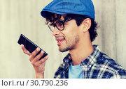 Купить «man using voice command or calling on smartphone», фото № 30790236, снято 15 июня 2016 г. (c) Syda Productions / Фотобанк Лори