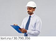 Купить «architect or businessman in helmet with clipboard», фото № 30790356, снято 12 января 2019 г. (c) Syda Productions / Фотобанк Лори