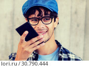 Купить «man using voice command or calling on smartphone», фото № 30790444, снято 15 июня 2016 г. (c) Syda Productions / Фотобанк Лори