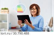 Купить «senior woman using tablet pc with energy chart», фото № 30790488, снято 8 февраля 2019 г. (c) Syda Productions / Фотобанк Лори