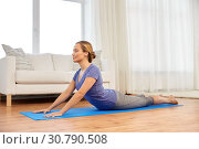 Купить «woman doing yoga cobra pose at home», фото № 30790508, снято 13 ноября 2015 г. (c) Syda Productions / Фотобанк Лори
