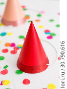 Купить «red birthday party cap and confetti», фото № 30790616, снято 6 июля 2018 г. (c) Syda Productions / Фотобанк Лори