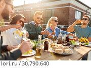 Купить «friends having dinner or bbq party on rooftop», фото № 30790640, снято 2 сентября 2018 г. (c) Syda Productions / Фотобанк Лори