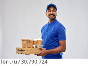 Купить «happy indian delivery man with food and drinks», фото № 30790724, снято 12 января 2019 г. (c) Syda Productions / Фотобанк Лори