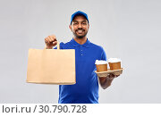 Купить «happy indian delivery man with food and drinks», фото № 30790728, снято 12 января 2019 г. (c) Syda Productions / Фотобанк Лори