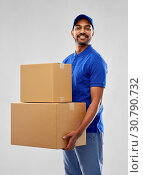 Купить «happy indian delivery man with parcel boxes», фото № 30790732, снято 12 января 2019 г. (c) Syda Productions / Фотобанк Лори