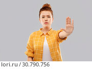 Купить «red haired teenage girl making stopping gesture», фото № 30790756, снято 28 февраля 2019 г. (c) Syda Productions / Фотобанк Лори