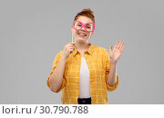 smiling red haired teenage girl with big glasses. Стоковое фото, фотограф Syda Productions / Фотобанк Лори