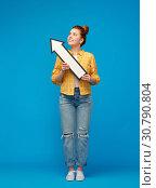 Купить «teenage girl with arrow shows north west direction», фото № 30790804, снято 28 февраля 2019 г. (c) Syda Productions / Фотобанк Лори