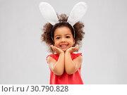 happy little girl wearing easter bunny ears posing. Стоковое фото, фотограф Syda Productions / Фотобанк Лори