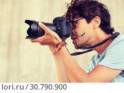 Купить «close up of photographer with camera shooting», фото № 30790900, снято 15 июня 2016 г. (c) Syda Productions / Фотобанк Лори