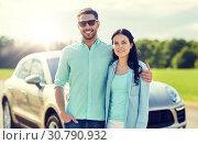 Купить «happy man and woman hugging at car», фото № 30790932, снято 12 июня 2016 г. (c) Syda Productions / Фотобанк Лори