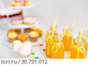 Купить «orange juice in glass bottles with paper straws», фото № 30791012, снято 6 июля 2018 г. (c) Syda Productions / Фотобанк Лори
