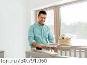 Купить «father with manual assembling baby bed at home», фото № 30791060, снято 10 февраля 2019 г. (c) Syda Productions / Фотобанк Лори